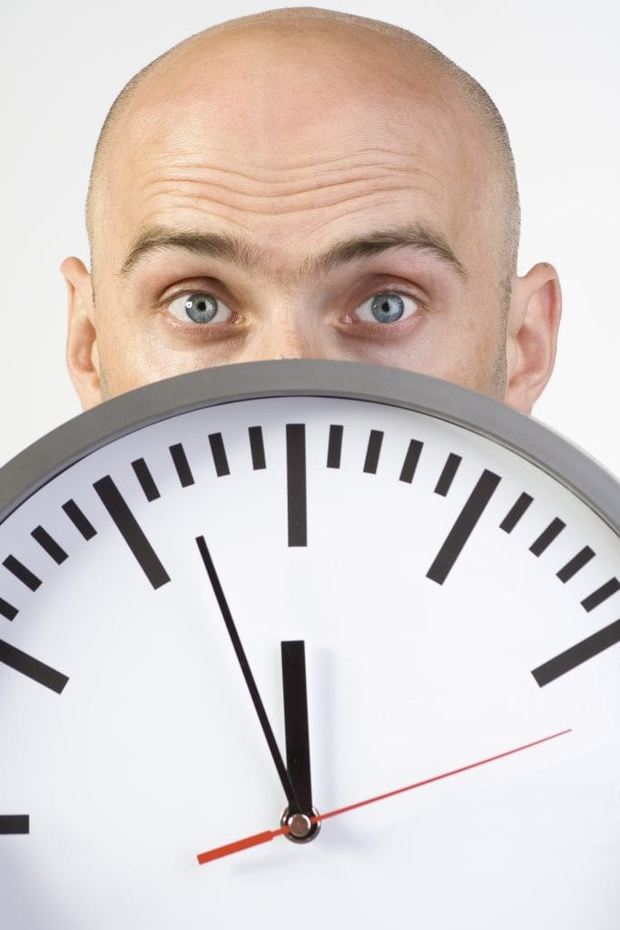 Bald man and clock - iStock_000004094908_Large
