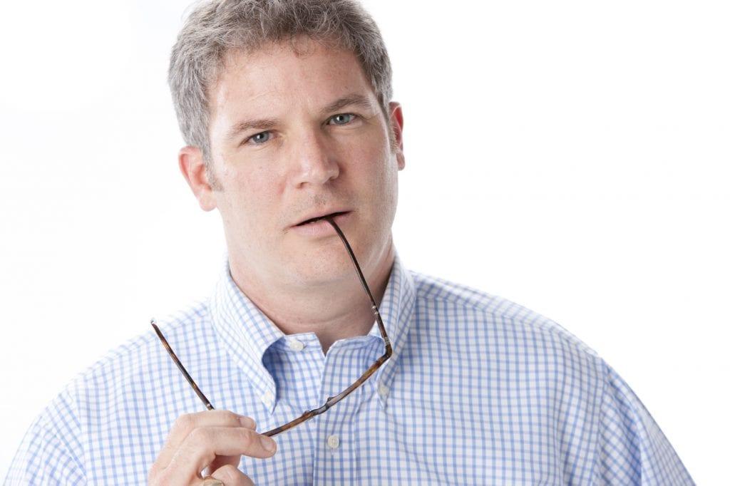 Man Chewing Glasses - iStock_000013996315_Medium