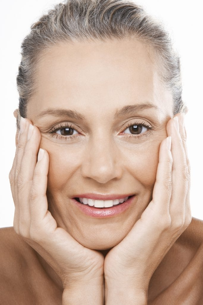 Mature Woman With Hands on Face - iStock_000032794814_Large