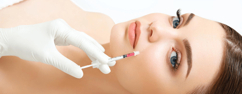 Women getting a dermal filler