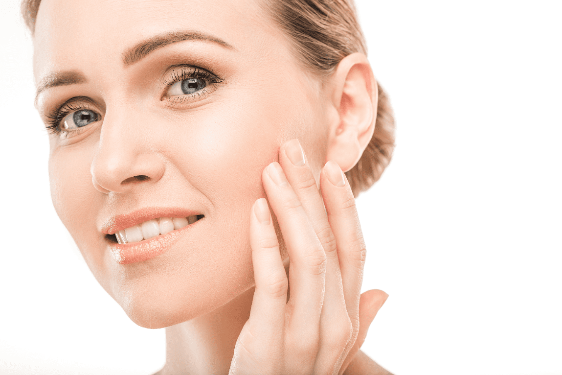 Woman showing off her radiant skin after a skin treatment