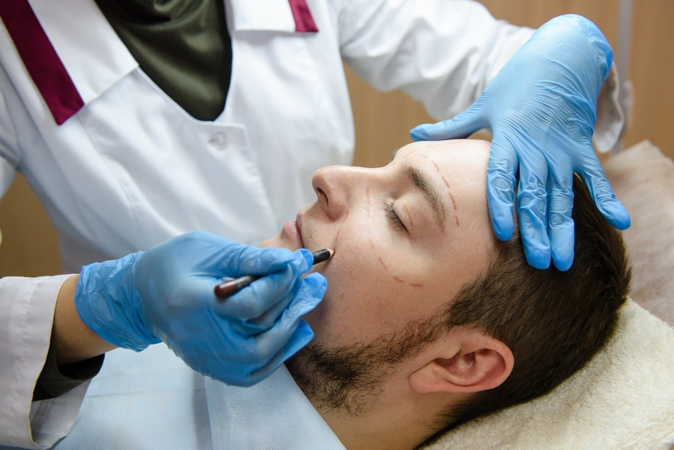 man receiving cosmetic treatment