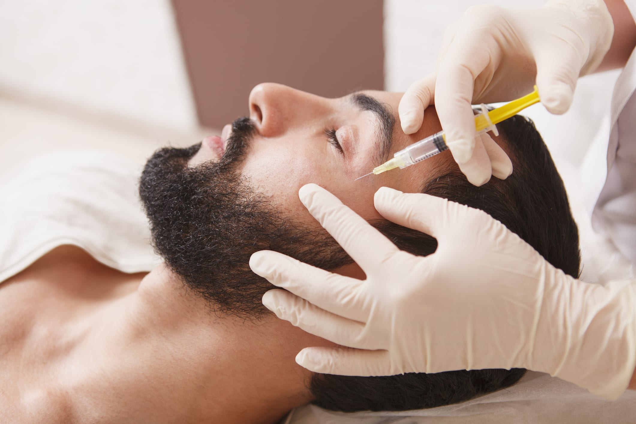 Man getting face filler injections