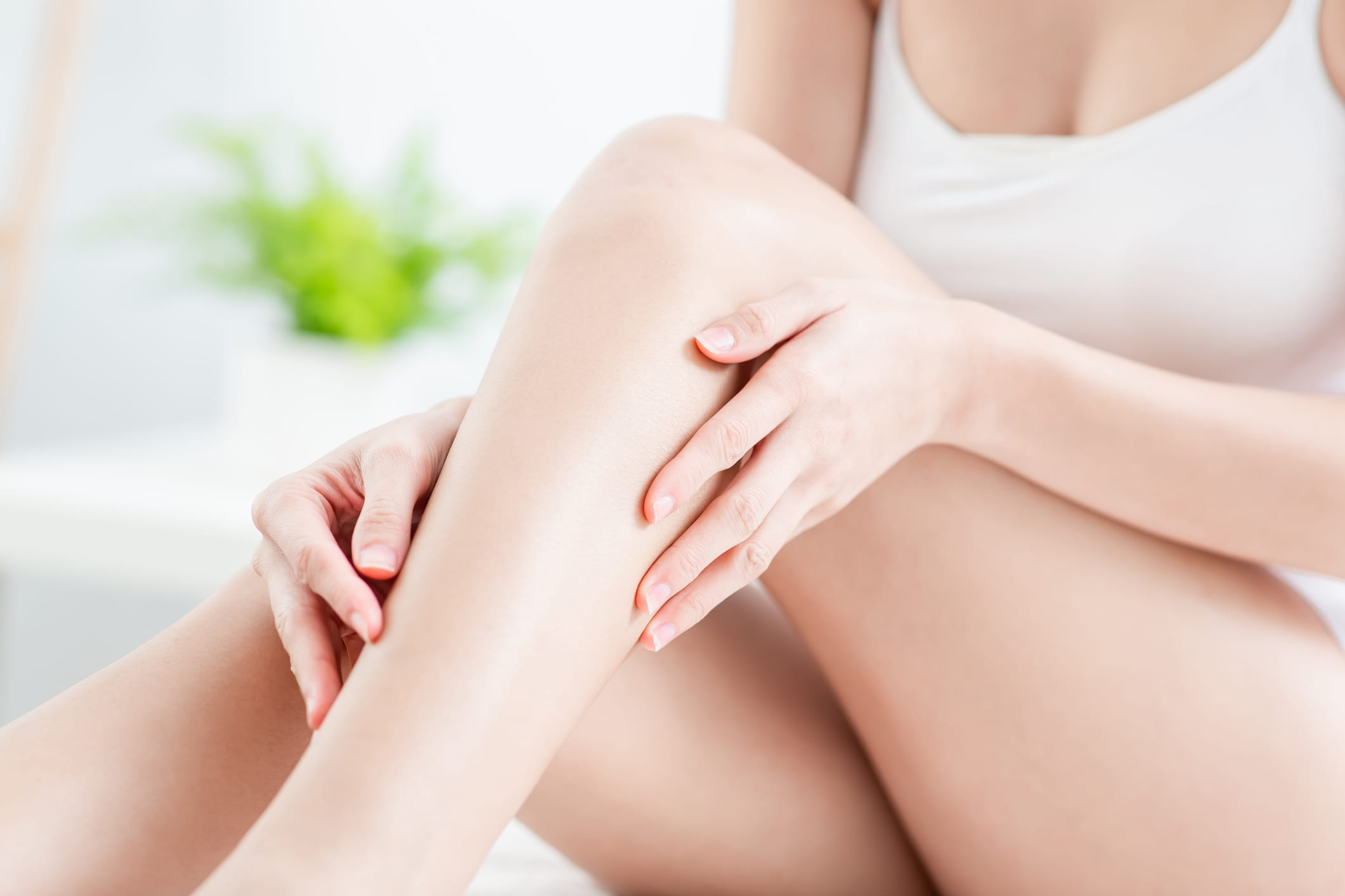 Woman touching her perfect smooth legs