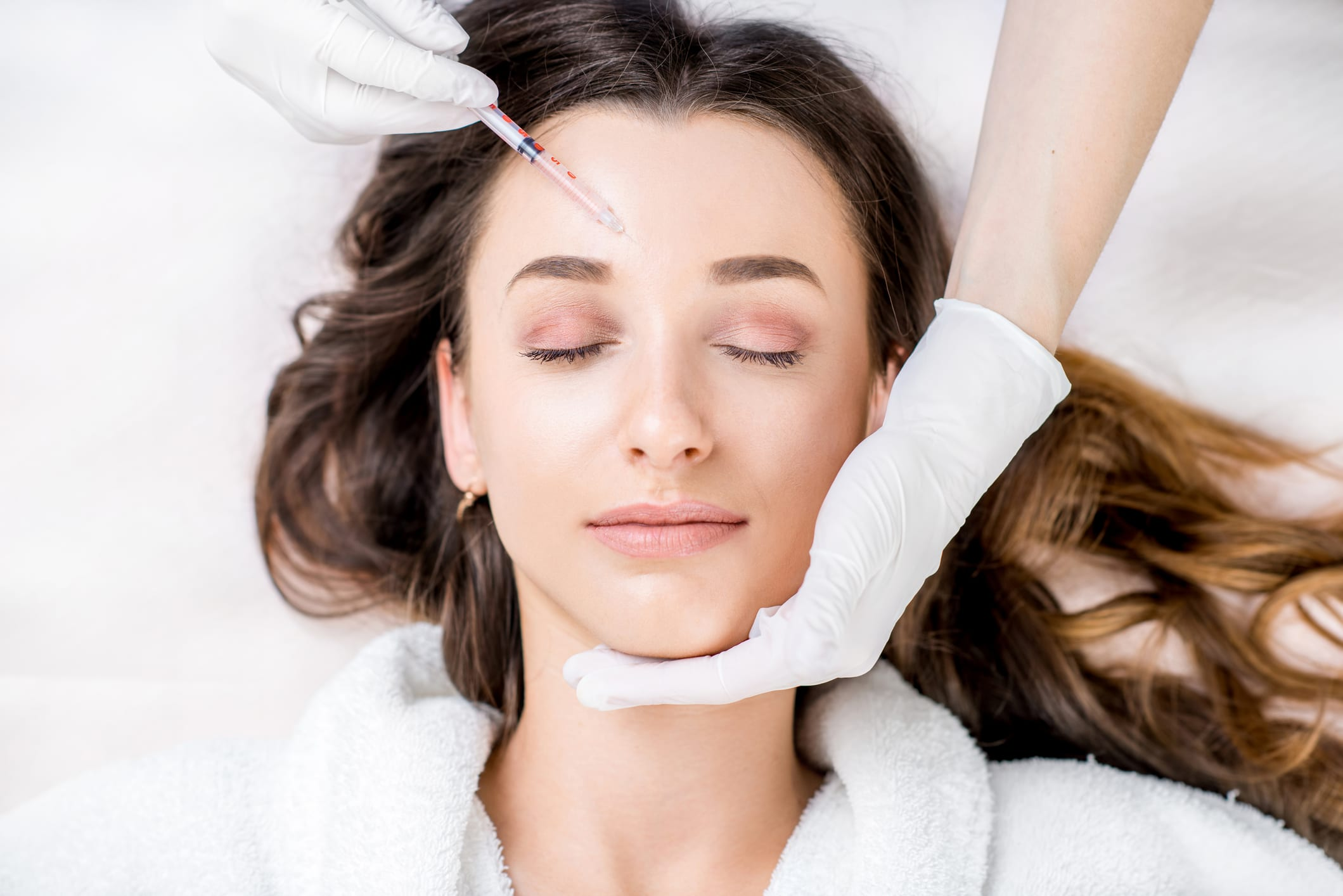 Woman receiving an anti-wrinkle injectioninjection