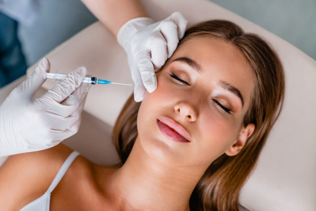 Woman getting anti-wrinkle injections